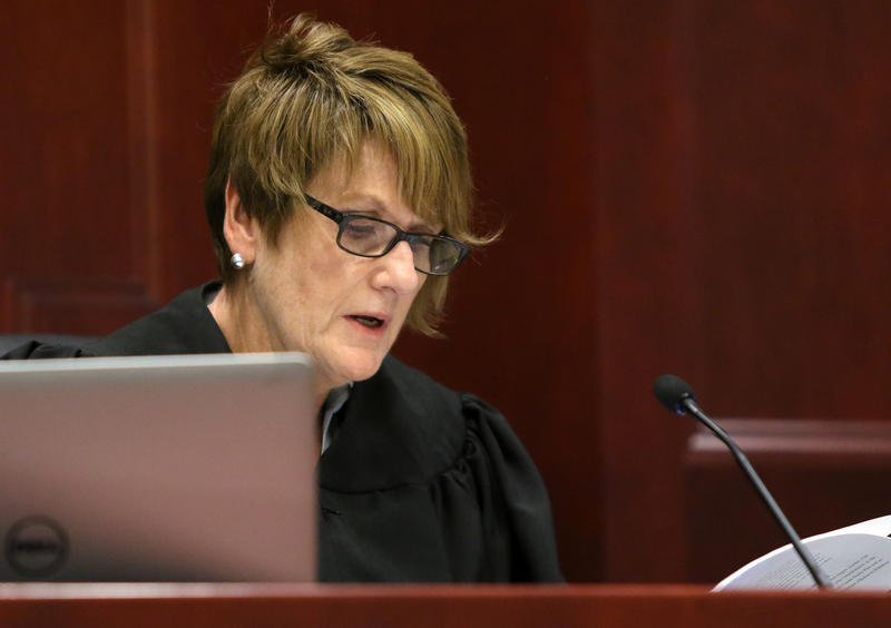 DeKalb County judge Robbin Stuckert reads from her 11-page opinion that denies William Curl from withdrawing his guilty plea from 2013.