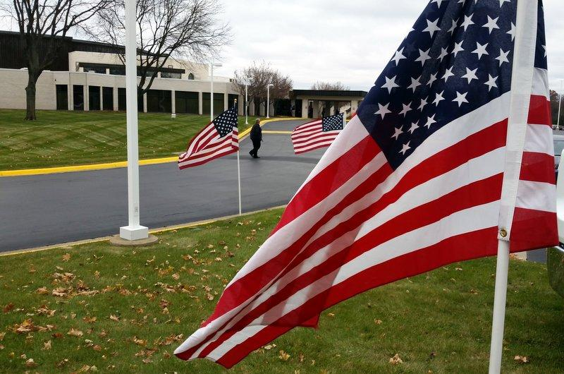 Flags line the drives at First Free Church for the visitation for Rockford Police Officer Jaimie Cox.