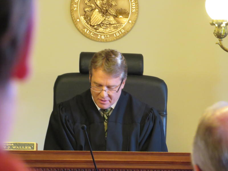 DeKalb County judge Bradley Waller reads his decision aloud during the Wednesday hearing.