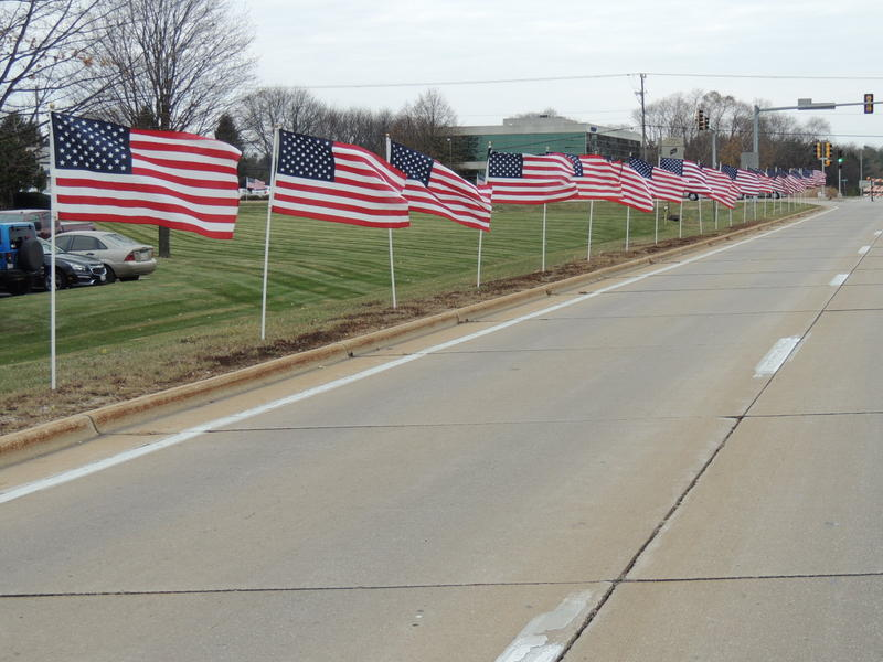 American flags flutter around the First Free Evangelical Church Frounds to honor fallen Rockford Police Officer Jaimie Cox, who also served in the Middle East with the National Guard.