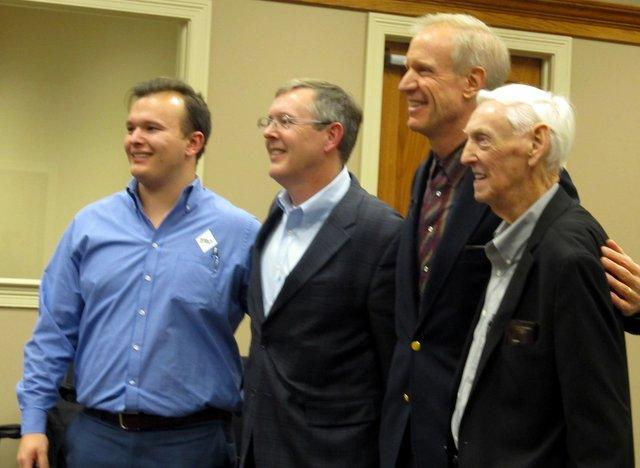Gov. Rauner poses for photos with three generations of owners of DeKalb Forge