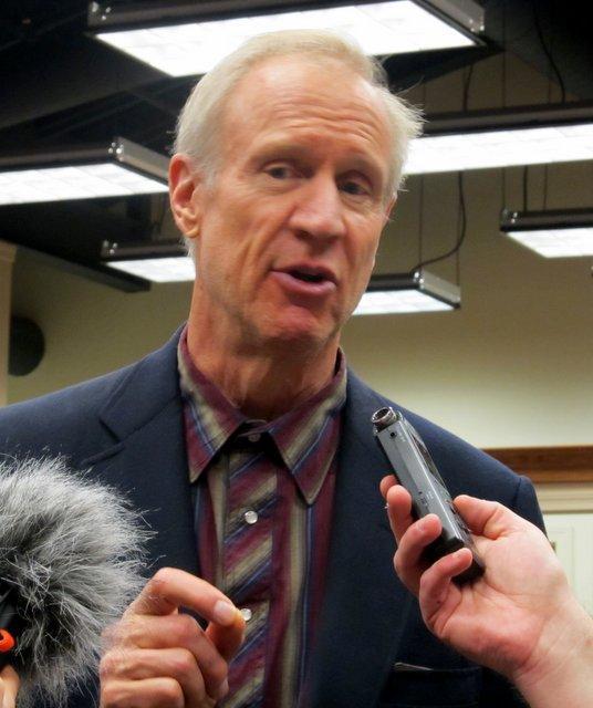 Gov. Bruce Rauner speaks with reporters in DeKalb