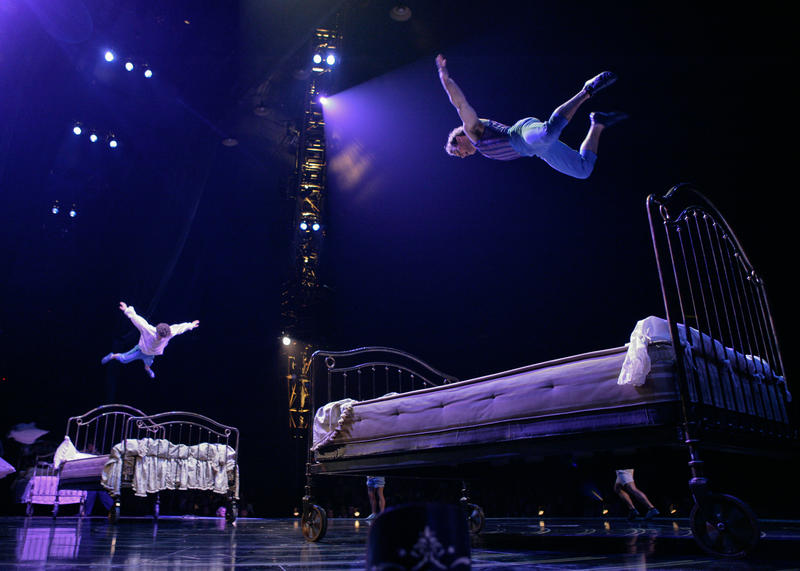 The show's acts allude to the different stages of Mauro's life. This trampoline act represents his childhood.