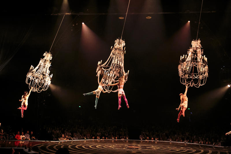These acrobats on chandaliers are part of an act symbolizing Mauro's former lovers.