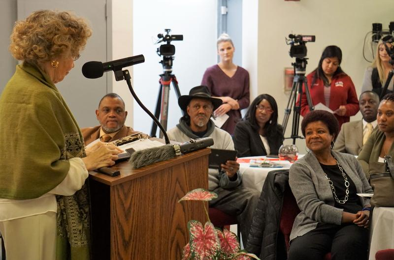 Coleen Martin Williams reads her poem about Chuck Jefferson to the crowd at the dedication ceremony.