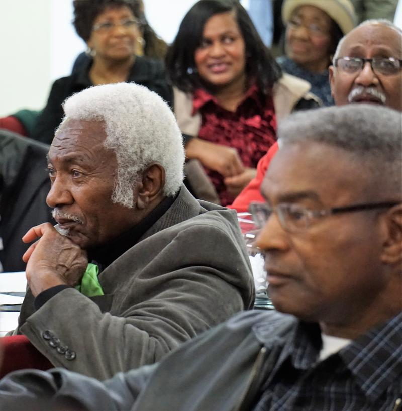 Retired alderman Victory Bell listens to long-time colleague Jefferson during ceremonies in his honor.