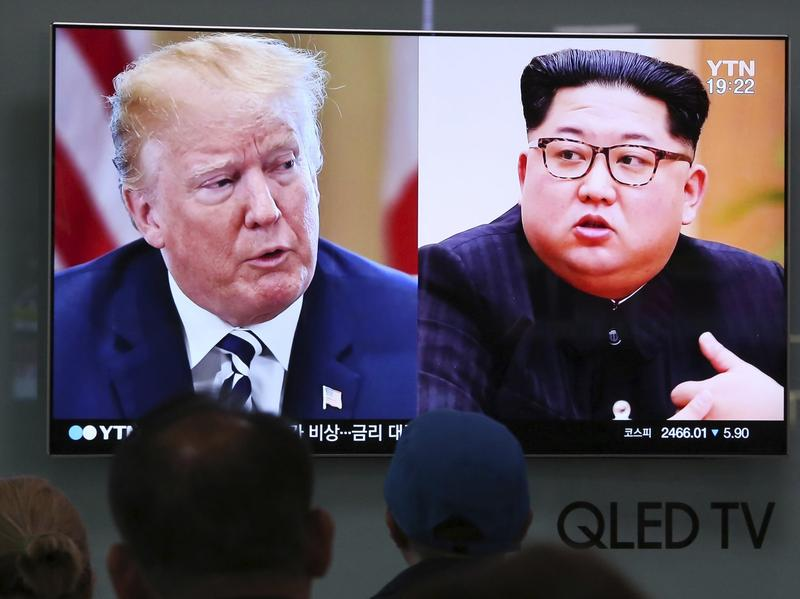 A war of words has scuttled a June 12 summit between President Trump and North Korean leader Kim Jong Un, seen during a news broadcast Wednesday in Seoul.