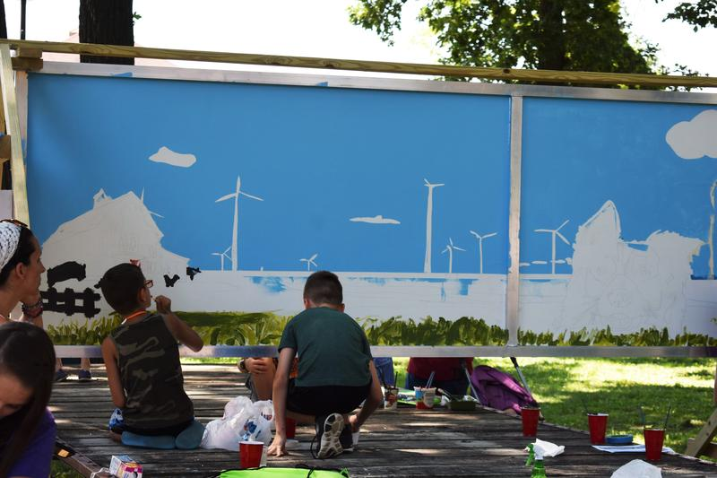 Children were invited to join in on a collective Kid's Mural, painted in City Park.