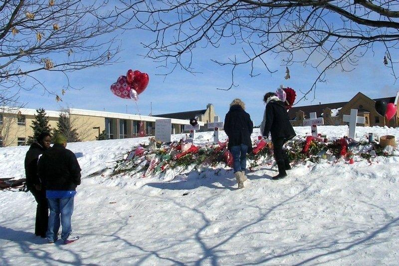 This makeshift memorial of crosses was set up outside Cole Hall in February 2008 following the shootings that took five lives. Artifacts from this memorial were collected for the NIU archives.