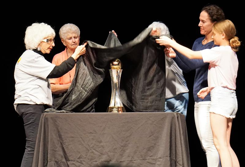 Three generations of ballplayers unveil the Women's Baseball World Cup trophy on its first stop as it makes its way to Florida, site of the tournament in August.