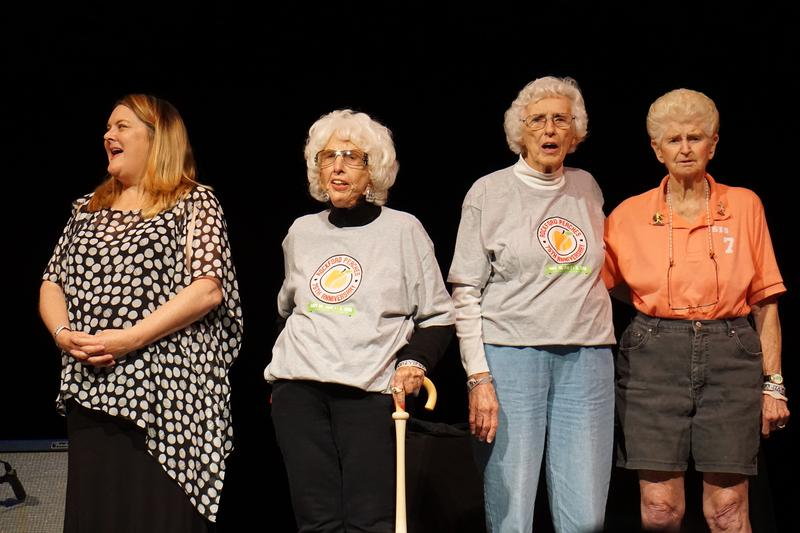 """Actress Megan Cavanagh and players Maybelle Blair, Shirley Burkovich, and Helen Wyatt sing the AAGPBL's official theme, """"Victory Song."""""""
