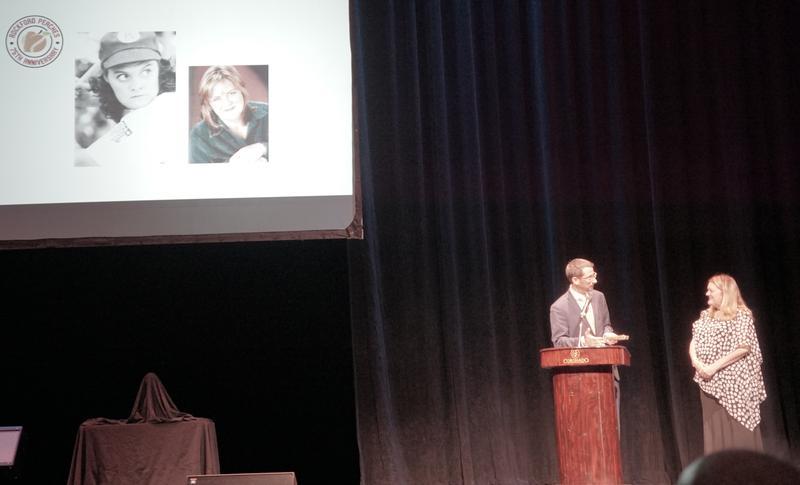 "Rockford Mayor Tom McNamara presents the key to the city to Megan Cavanagh, who portrayed Peach Marla Hooch in ""A League of Their Own."""