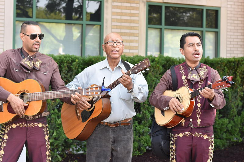 The rally opened up with a performance by Mariachi Lira de Rockford. Three of six performers are pictured.