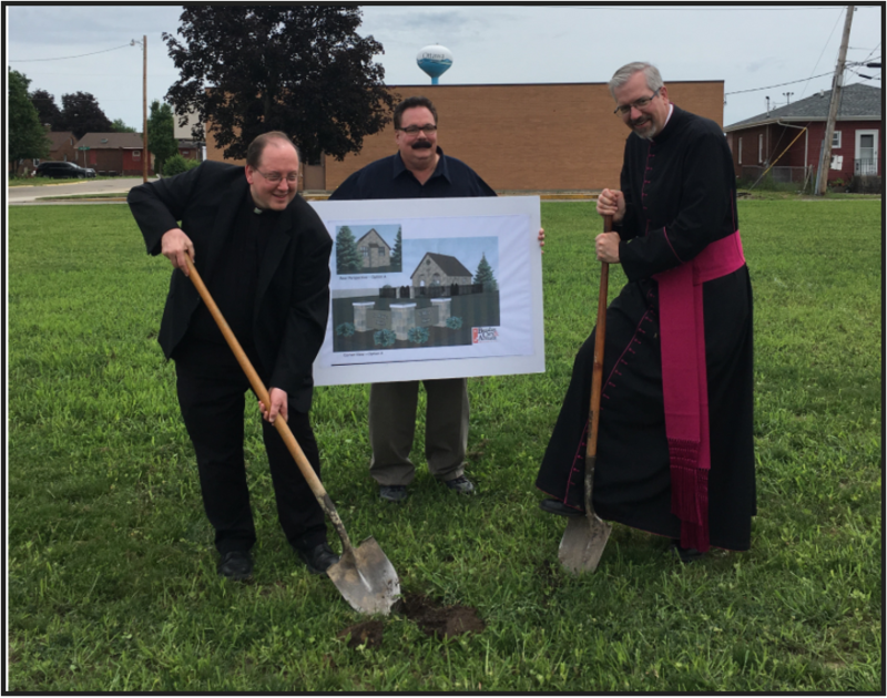Fr. David Kipfer, parishioner Bill Mucci, and Msgr. Phillip Halfacre break ground on a grotto at the former site of St. Mary's Church in Naplate.
