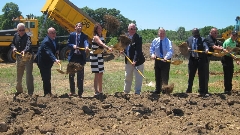 Rep. Cheri Bustos and Sen. Dick Durbin join local politicians and airport officials in breaking ground on a Rockford Airport expansion.