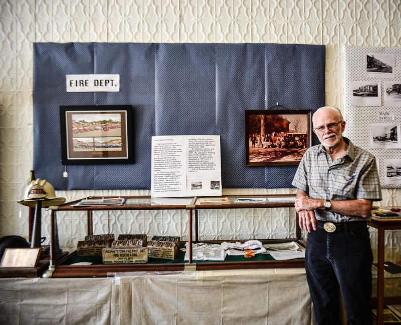 Fred South stands in front of the display of the 2013 fire. South is a volunteer historian for Prophetstown