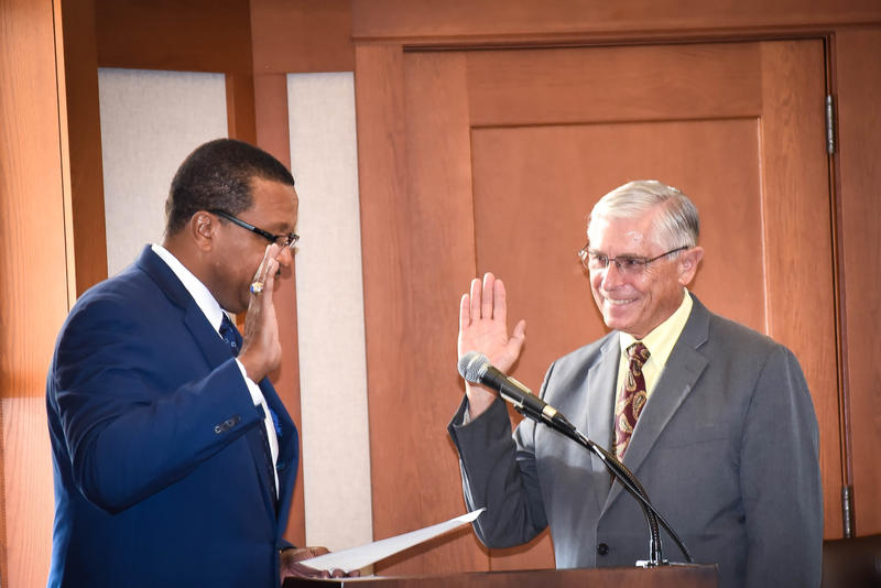 Former Rep. Bob Pritchard (right) is sworn in by NIU Board Chairman Wheeler Coleman.