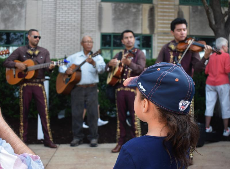 A child watches Mariachi Lira perform in Rockford.