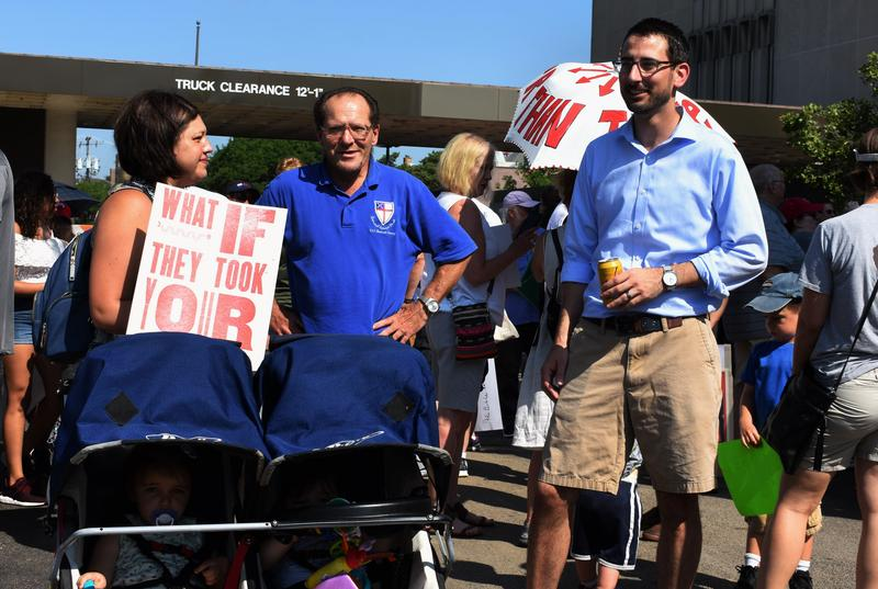 Mayor Tom McNamara joined alongside demonstrators. He's pictured here on the right, before the march began.