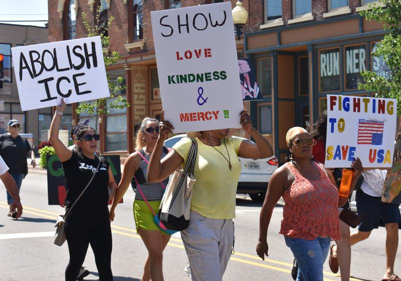 """Demonstrators walk with signs. One reads """"Abolish ICE."""" The movement to disassemble ICE is gaining traction amongst some politicians, including Wisconsin Rep. Mark Pocan (D-2nd District)."""