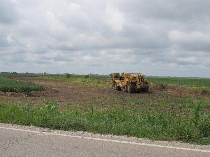 Clearing and utility work has begun on a soybean field south of Rochelle slated for development