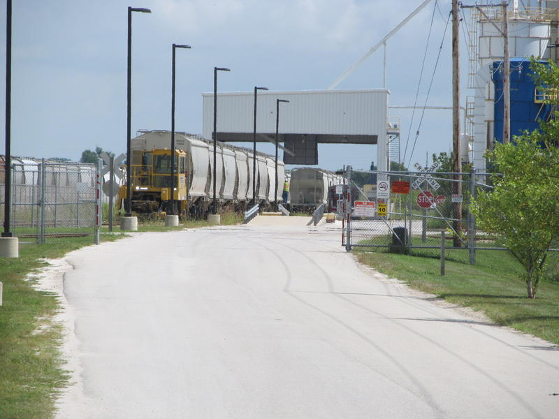 A set of rail cars is moved to the fracking sand facility in Rochelle