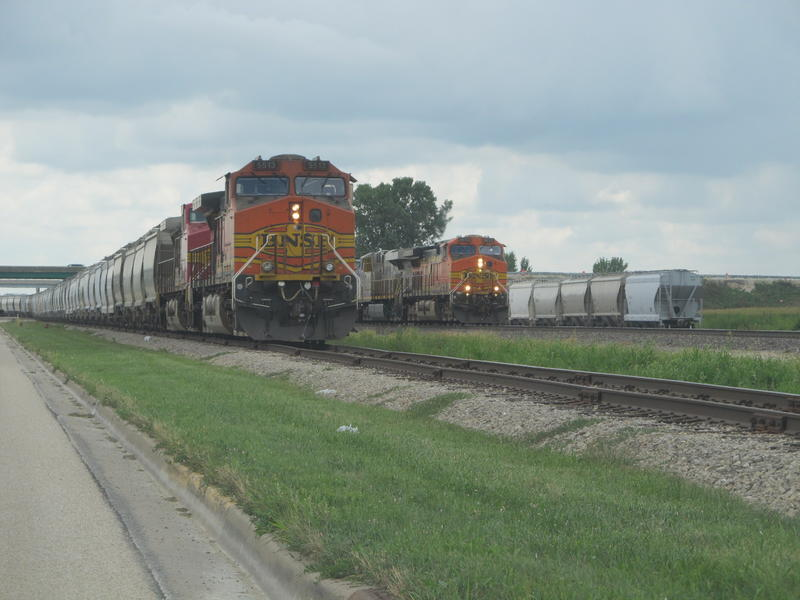 BNSF trains wait to move from the rail park onto the main line
