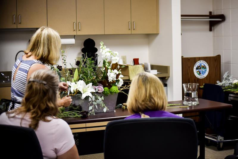 Janet Gallagher, Kishwaukee Floral Design Instructor, showed area teachers how to make floral bouquets and arrangements.
