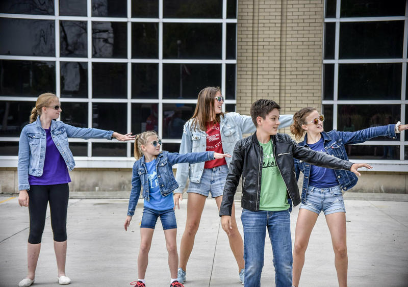 """The Rockford Dance Company performed to the song, """"Grease Lightning,"""" in front of the Rockford Register Star building."""