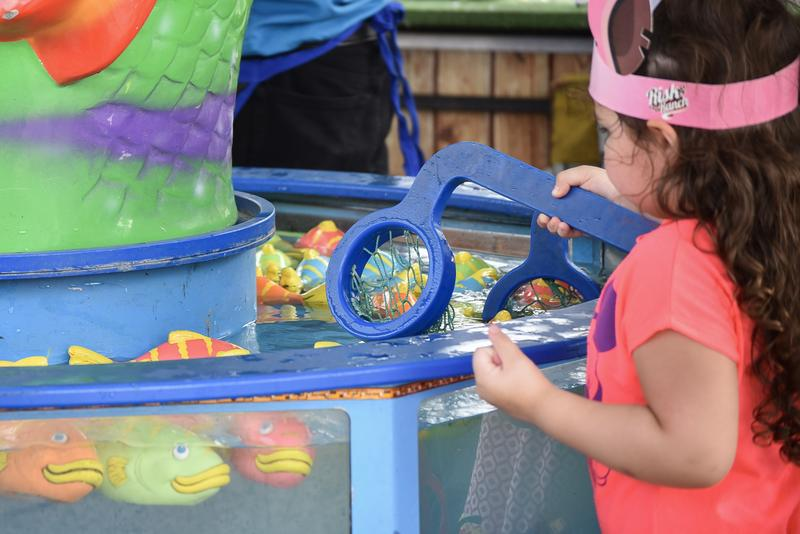 A popular game for young children was the fishing game. The goal is to catch a fish a win a prize