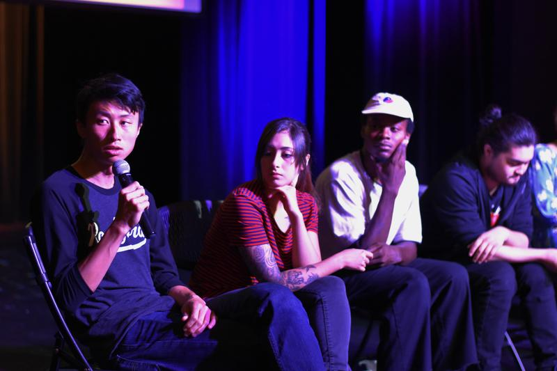 Filmmaker Bing Liu participates in a community discussion after a screening of his documentary. To Liu's left sit Nina, Keire, and Kent, who are featured in the film.