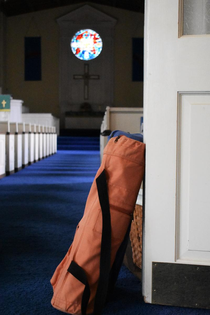 Packed yoga mats lean on the door to the chapel of First Congregational UCC.