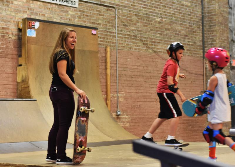 Ariel Ries smiles and teaches a skating class in the Fargo Skateboarding park.