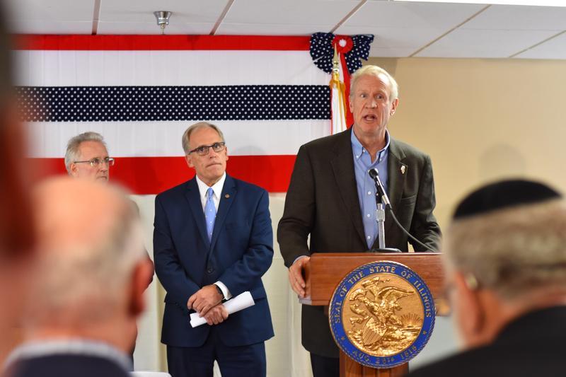 Senator Dave Syverson and Senator John Mulroe stand alongside Rauner. The two Senators led the creation of the legislation.