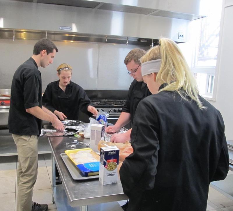 Chef Steve Konefes works with CareerTec students at Pretzel City Kitchens