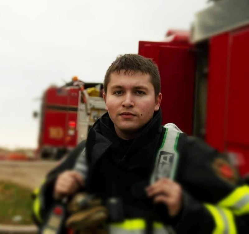 Jace Pesina in fire protection gear. He works as an EMT, basic certification, with a fire department.