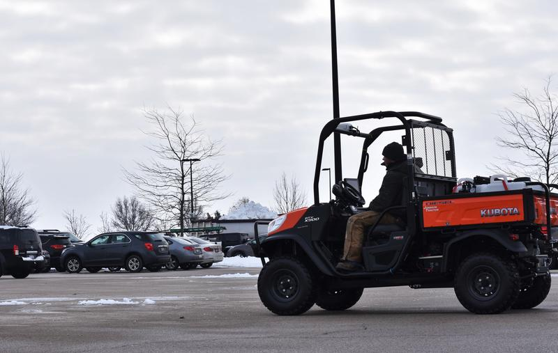 Kyle Male sits in the outfitted UTV. The 4-wheeler is able to auto-steer using GPS, a technology already used by combines and tractors.