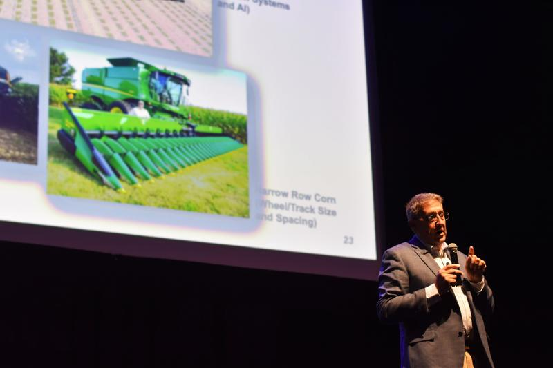 Ohio State University chair Scott Schearer gives a presentation on technological advances in farm machinery.