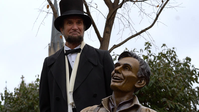 Lincoln presenter Michael Krebs stands with his laughing counterpart as part of the unveiling ceremony.