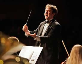 RSYO Music Director Daniel Black leads his orchestra in performance