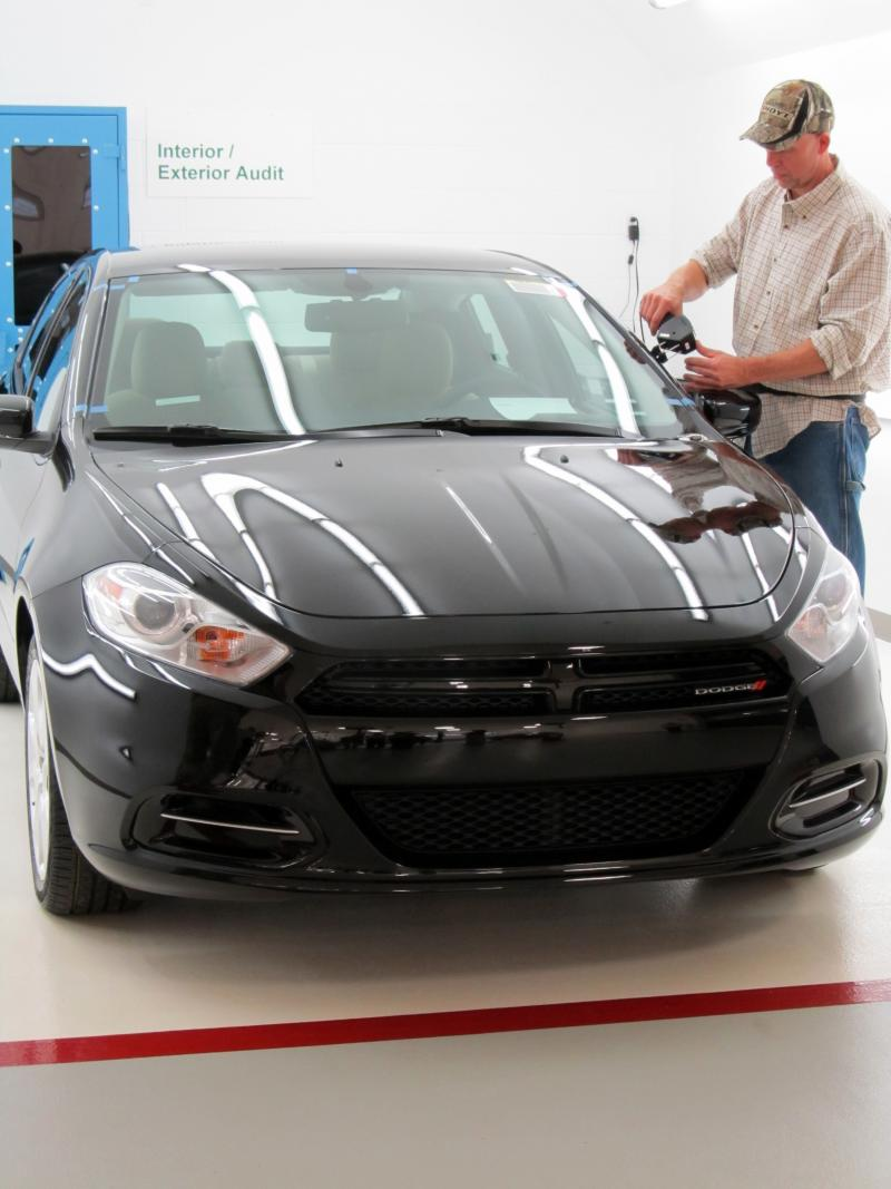 Checking the gaps in the body of Chrysler's new Dodge Dart.