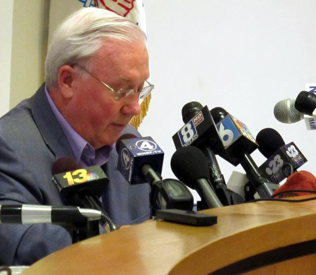 Dixon Mayor Jim Burke reads from a prepared statement at Wednesday's news conference