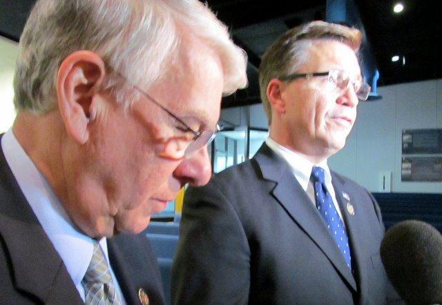 Congressmen Don Manzullo and Bobby Schiller talk about transportation funding at the Chicago-Rockford International Airport.