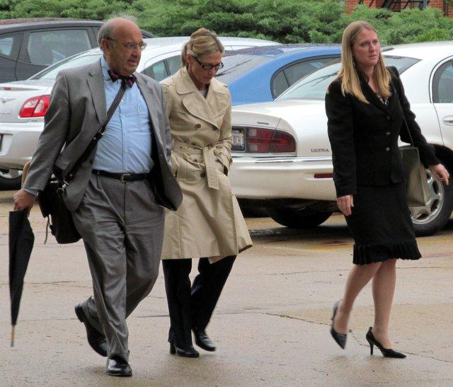 Rita Crundwell leaves the federal courthouse in Rockford, flanked by her attorneys Paul Gaziano and Kristen Carpenter