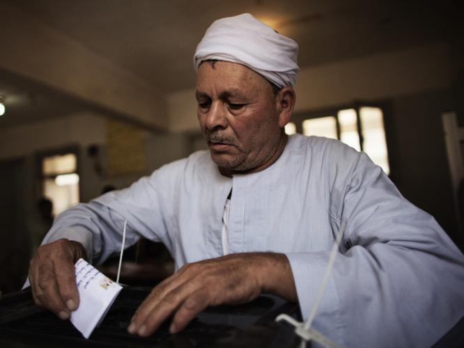 In Cairo, a man casts his ballot earlier today.