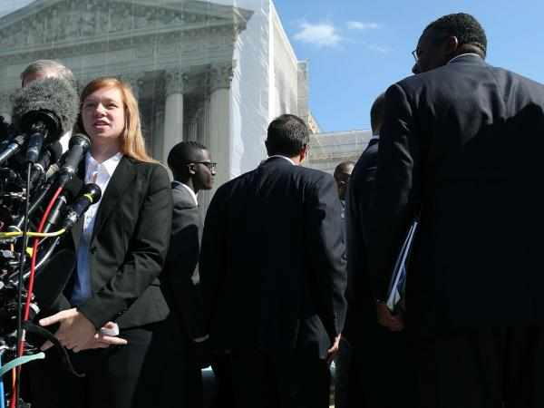 Abigail Noel Fisher, who challenged a racial component to University of Texas at Austin's policy, speaks to the media outside the U.S. Supreme Court building during oral in the case in October.