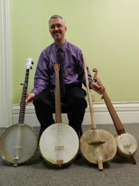 Greg Adams brought four different banjos to help tell the history of the instrument's rocky traverse from Africa to North America. The two on the right have gourd bodies and are still played by musicians in West Africa.