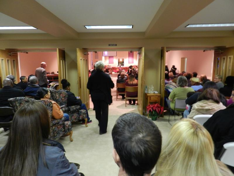 The sanctuary at East Side Christian Church was so full, ushers had to arrange rows of chairs in the gathering space. Still, some visitors had to stand.