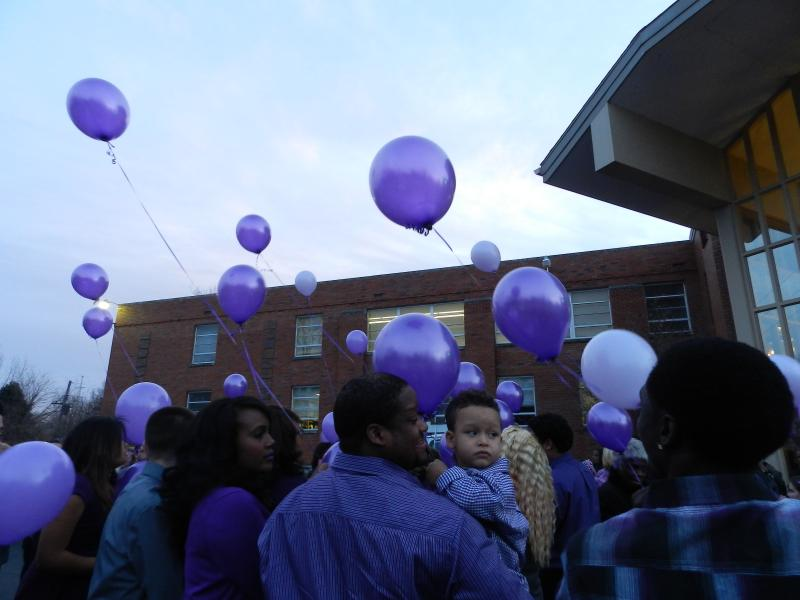 Family members release balloons into the sky after Nicholas Mathew's memorial service.