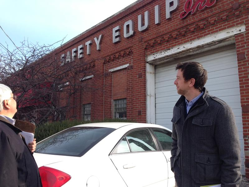 Historic preservation officer and designer Matt Wagner admire the metallic letters at Stagg Safety Equipment. They are originally from the old Chrysler plant.